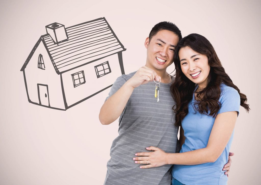 Digital composite of Couple Holding key with house drawing in front of vignette
